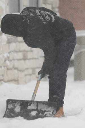 Jaylen Fuller shovels snow at the Genoa Township White Castle, having come from an Ann Arbor White Castle restaurant Monday, Jan. 28, 2019. Asked how his drive was, Fuller responded 'Not that bad.'