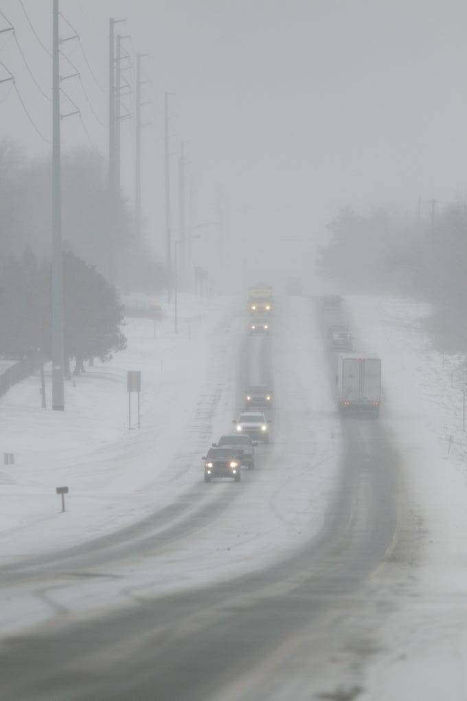 Visibility lessens in a snowstorm on M-59 in Oceola Township near Ironwood Golf Club Monday, Jan. 28, 2019.