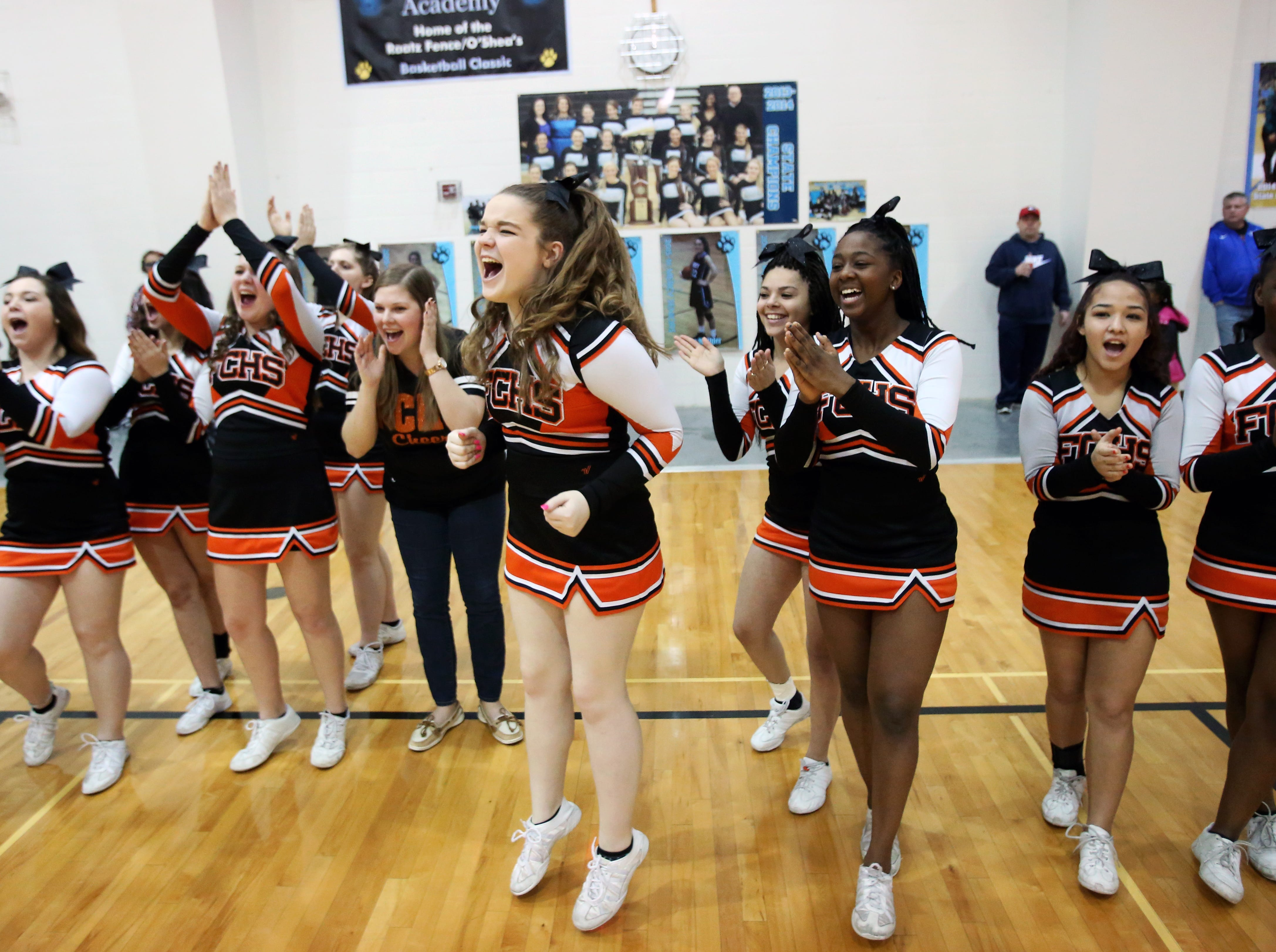 Fern Creek cheerleaders celebrate as the players get their awards for the evening.   Feb. 26, 2016
