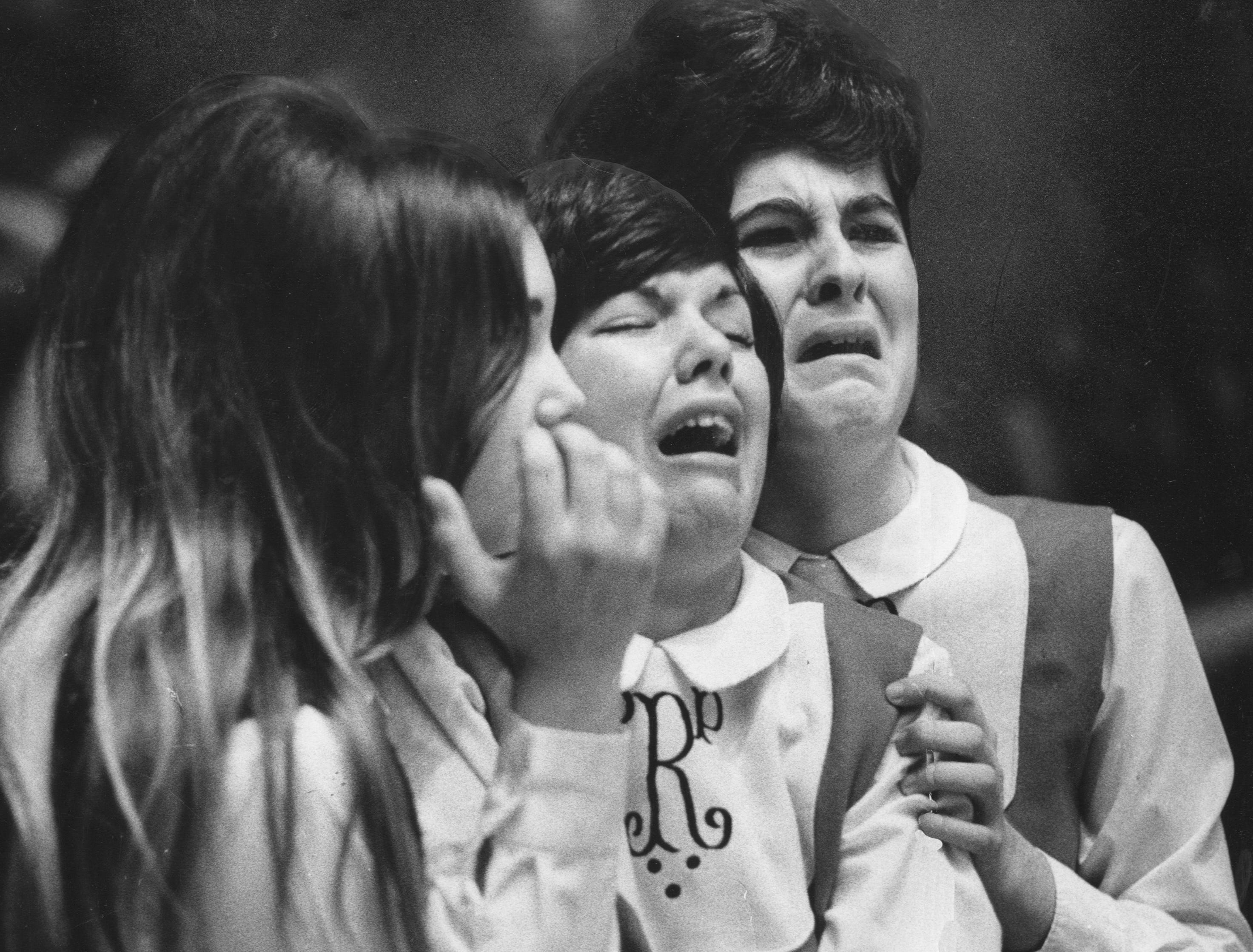 Cheerleaders at Pleasure Ridge Park High School break into tears as the team loses 58-52 to Male in the semifinals of the state basketball tournament. Mar. 22, 1970