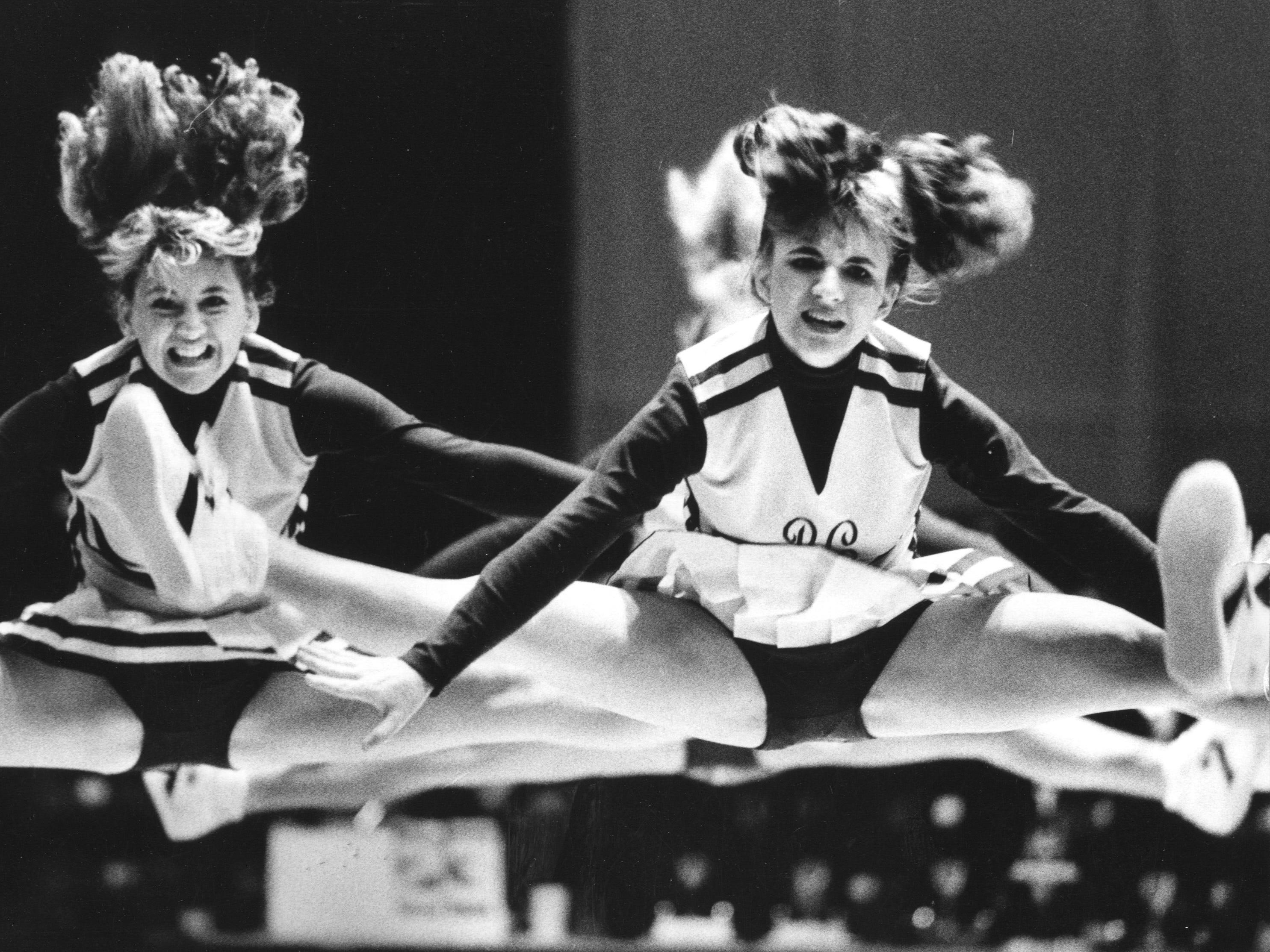 Barren's County's varsity cheerleaders performed yesterday at the YMCA cheerleading contest in Frankfort. Nov. 9, 1986