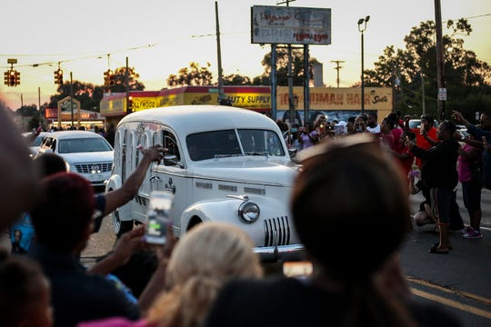 The hearse carrying the late Aretha Franklin drives down Seven Mile Road with the procession from Greater Grace Temple to Woodlawn Cemetery on Friday, August 31, 2018 in Detroit, Mich.