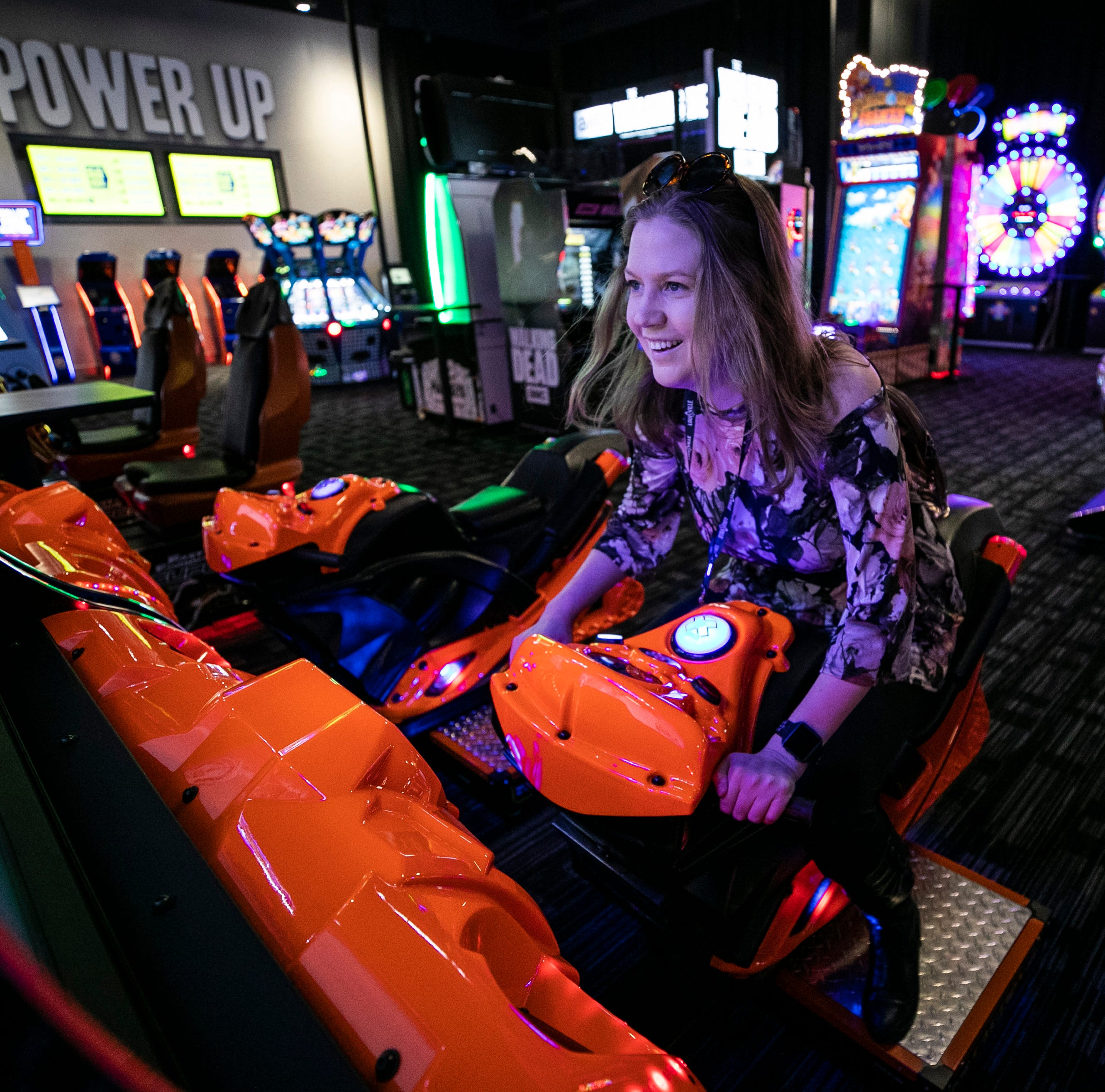 CJ Reporter Maggie Menderski takes a ride on a virtual racing snowmobile while checking out the new Dave and Buster's at the Mall St. Matthews. The establishment features a full menu with cocktails, beer from the full-service bar and arcade as well as video games for entertainment.