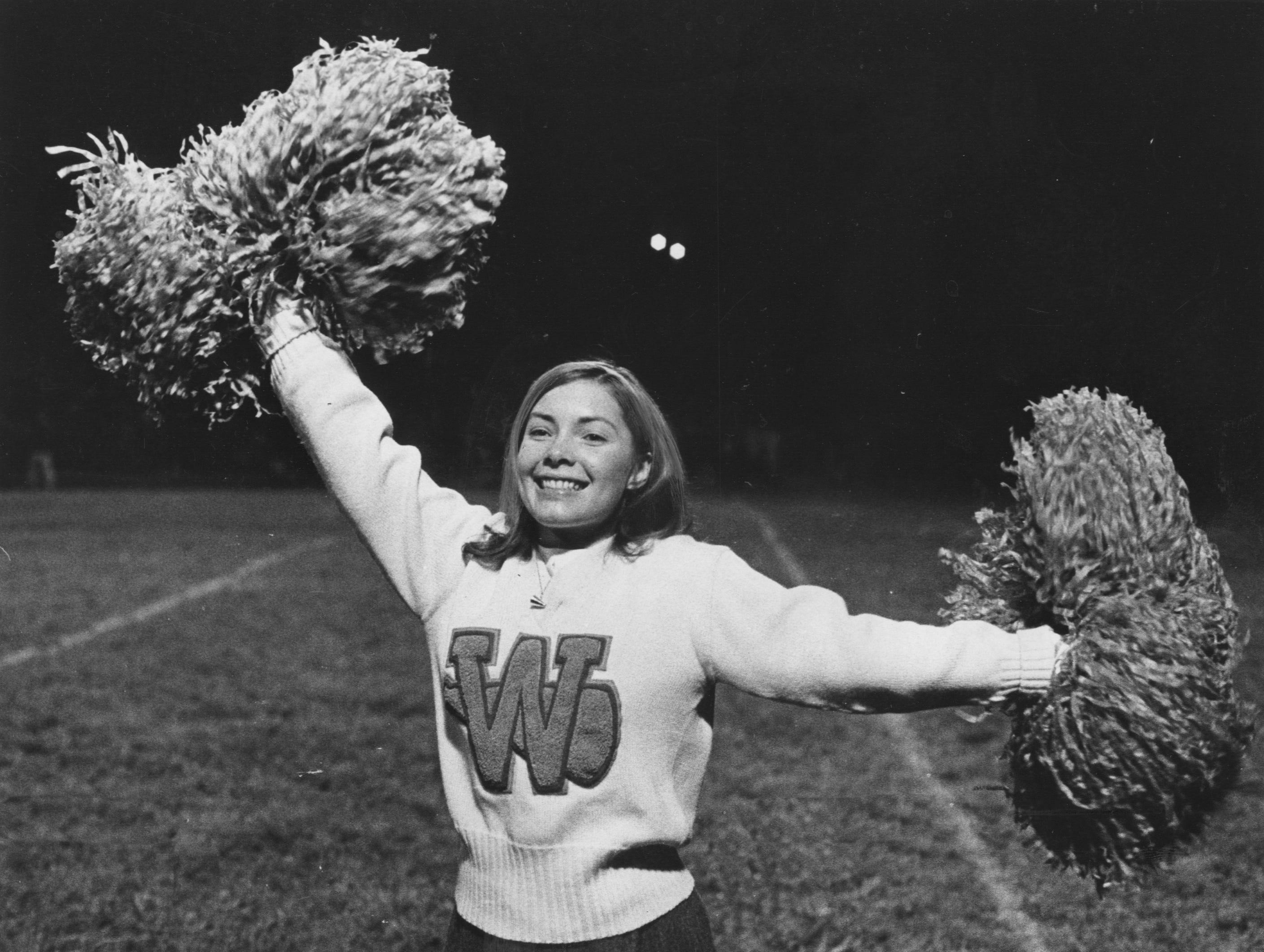 Cheerleader Cindy Millspaugh has been keeping spirits high at Waggener High this football season. Oct. 8, 1965