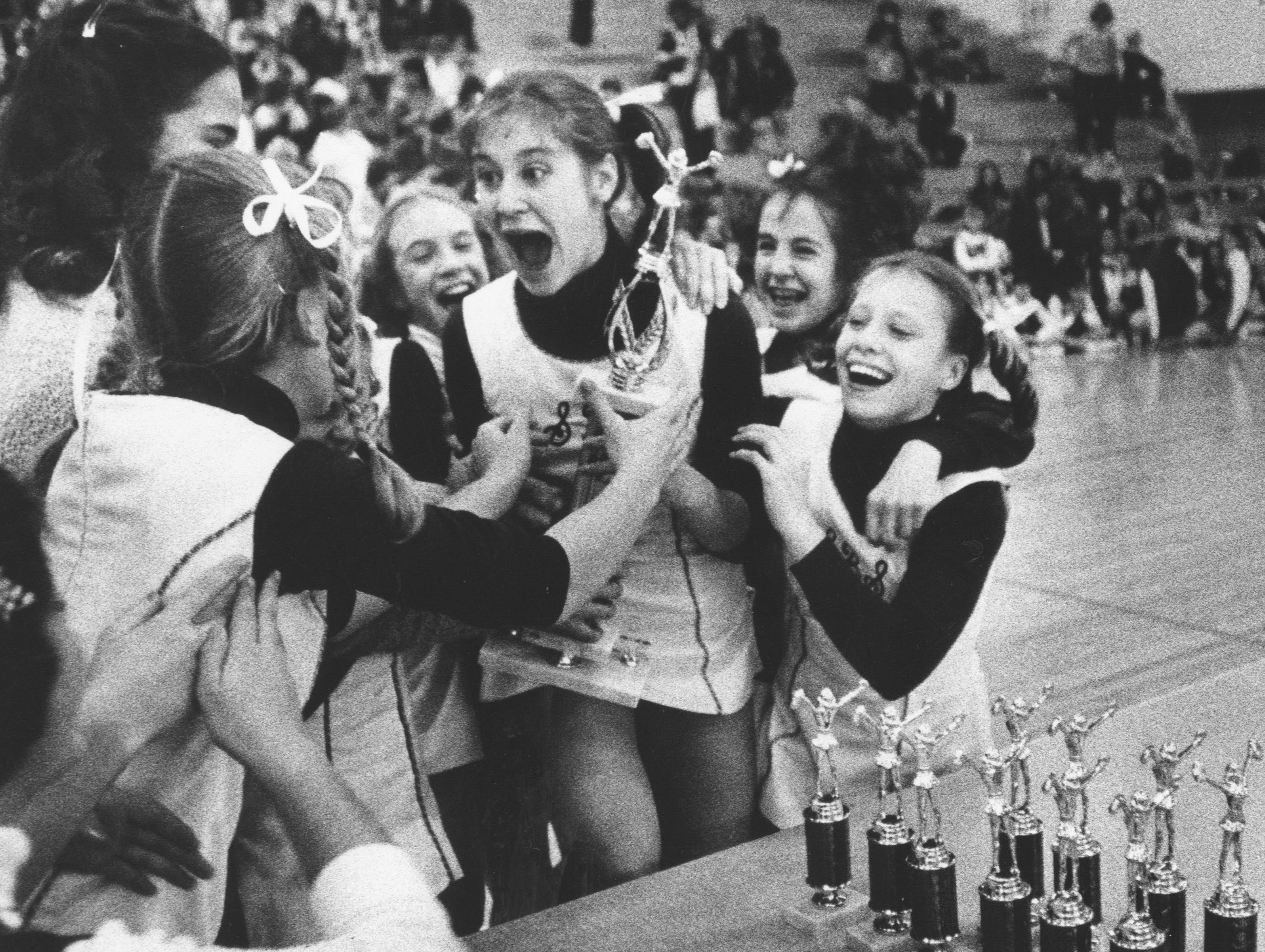 St. Barnabas cheerleaders celebrate after winning 1st place in the 7th/8th grade cheer competition. 1997