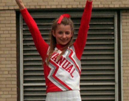 Manual cheerleaders Lynley Wolf holds Billie Phelps aloft during one of their stunts.2/27/96