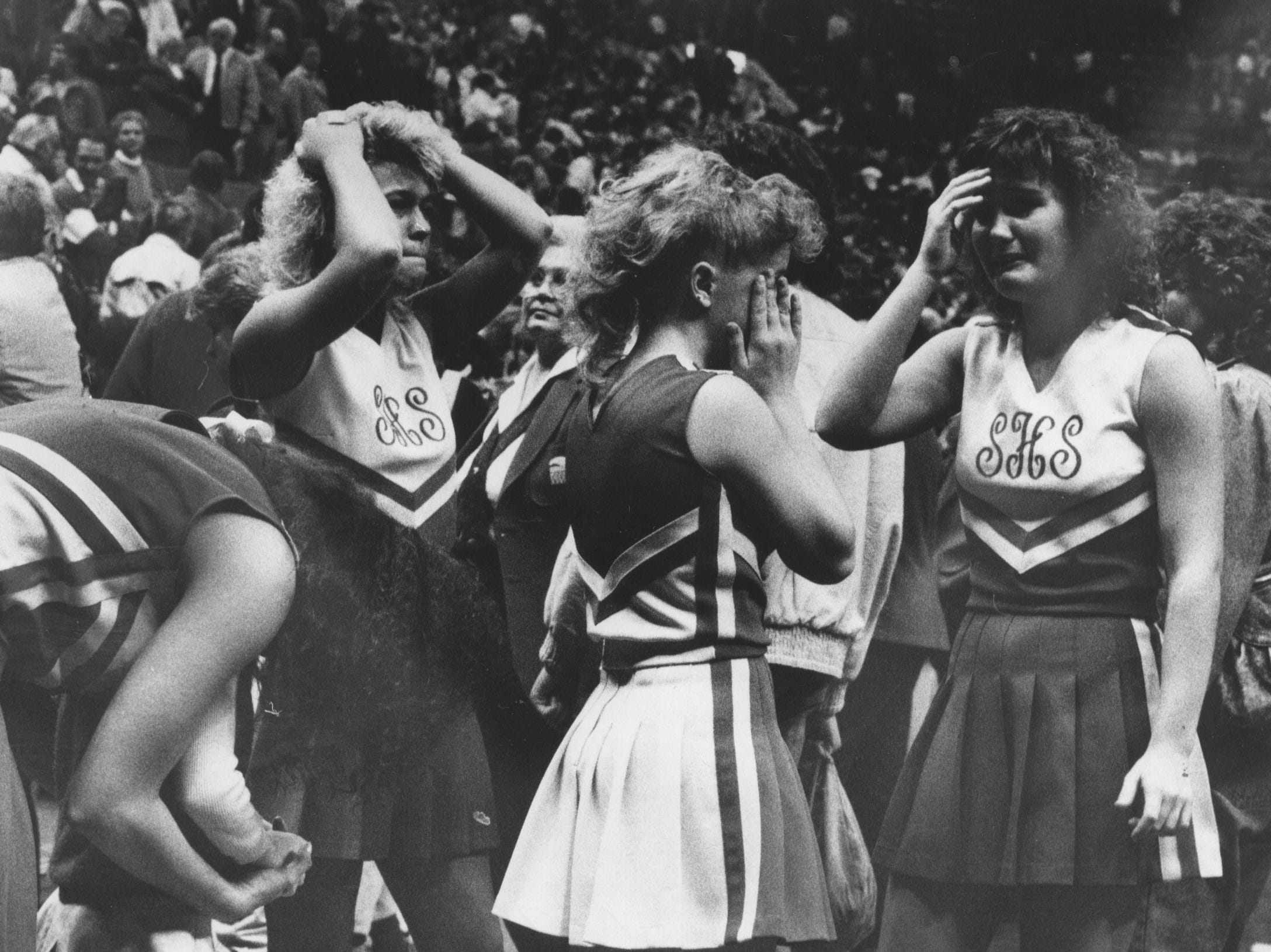Scottsburg's cheerleaders reacted with grief after the Warriorettes lost to Fort Wayne Snider 57-52 in the semifinal of the state championship yesterday. Feb. 27, 1988