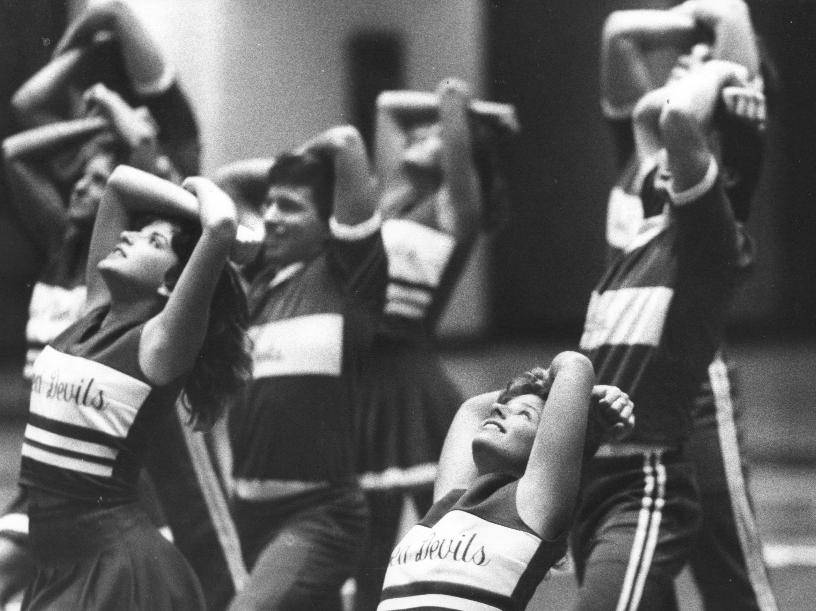The Jeffersonville High School cheerleaders performed yesterday at the school. The squad will participate after Christmas in the National Cheerleaders Association annual High School Cheerleaders National Championship in Florida. Dec. 23, 1986