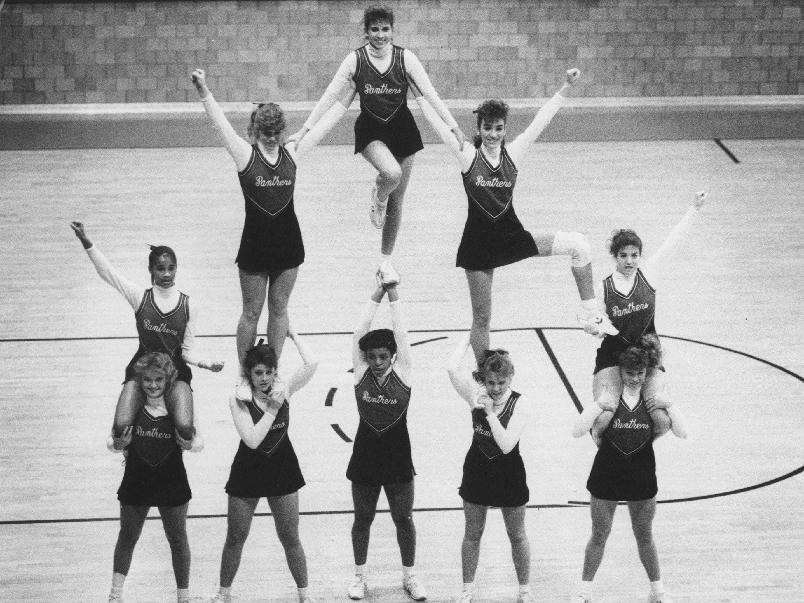 Pleasure Ridge Park cheerleaders performed a pyramid routine during a recent ball game. Jan. 20, 1987