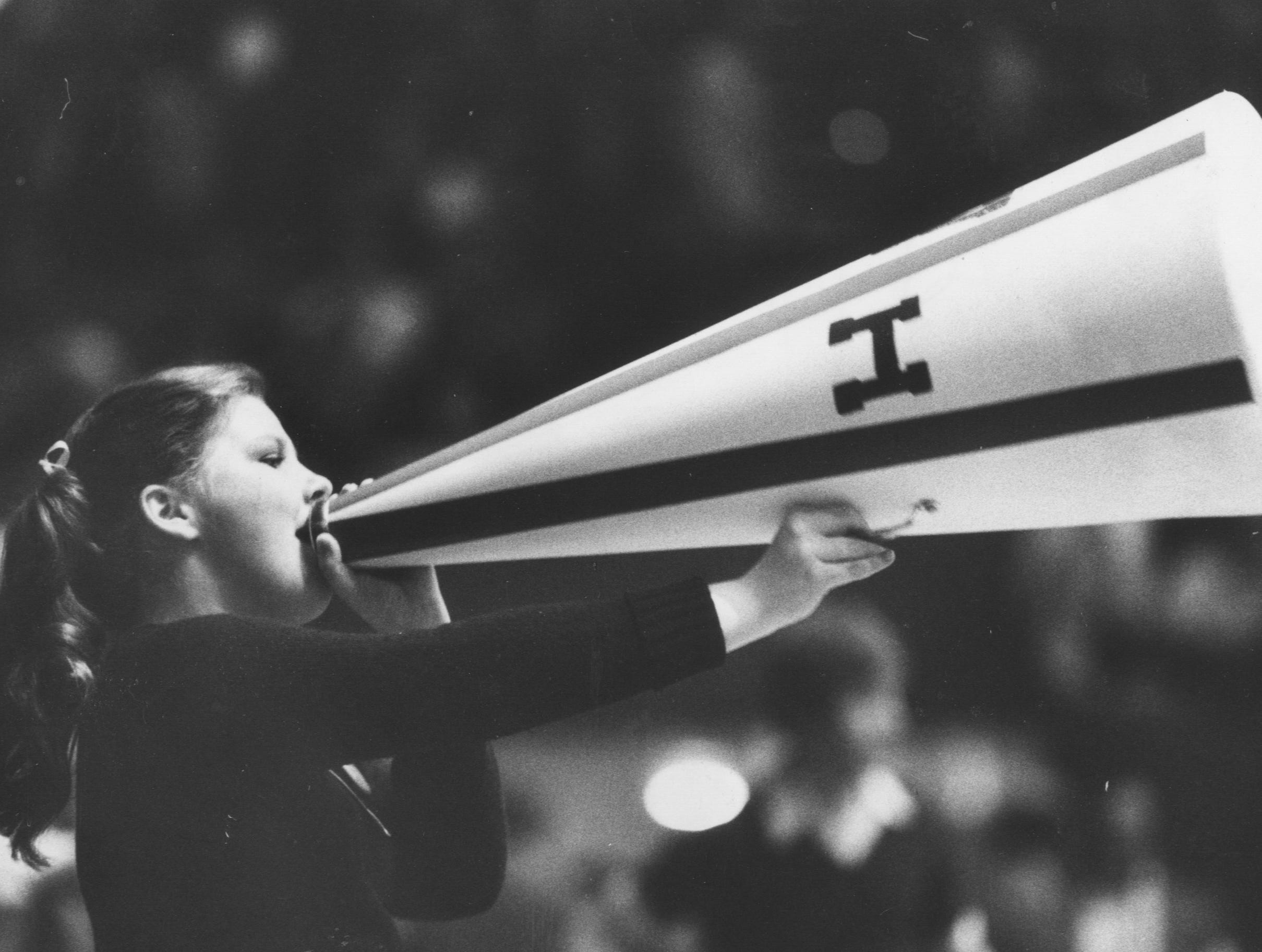 Donna Grace led cheers with a megaphone during the Sweet Sixteen game against Owensboro. Mar. 29, 1980