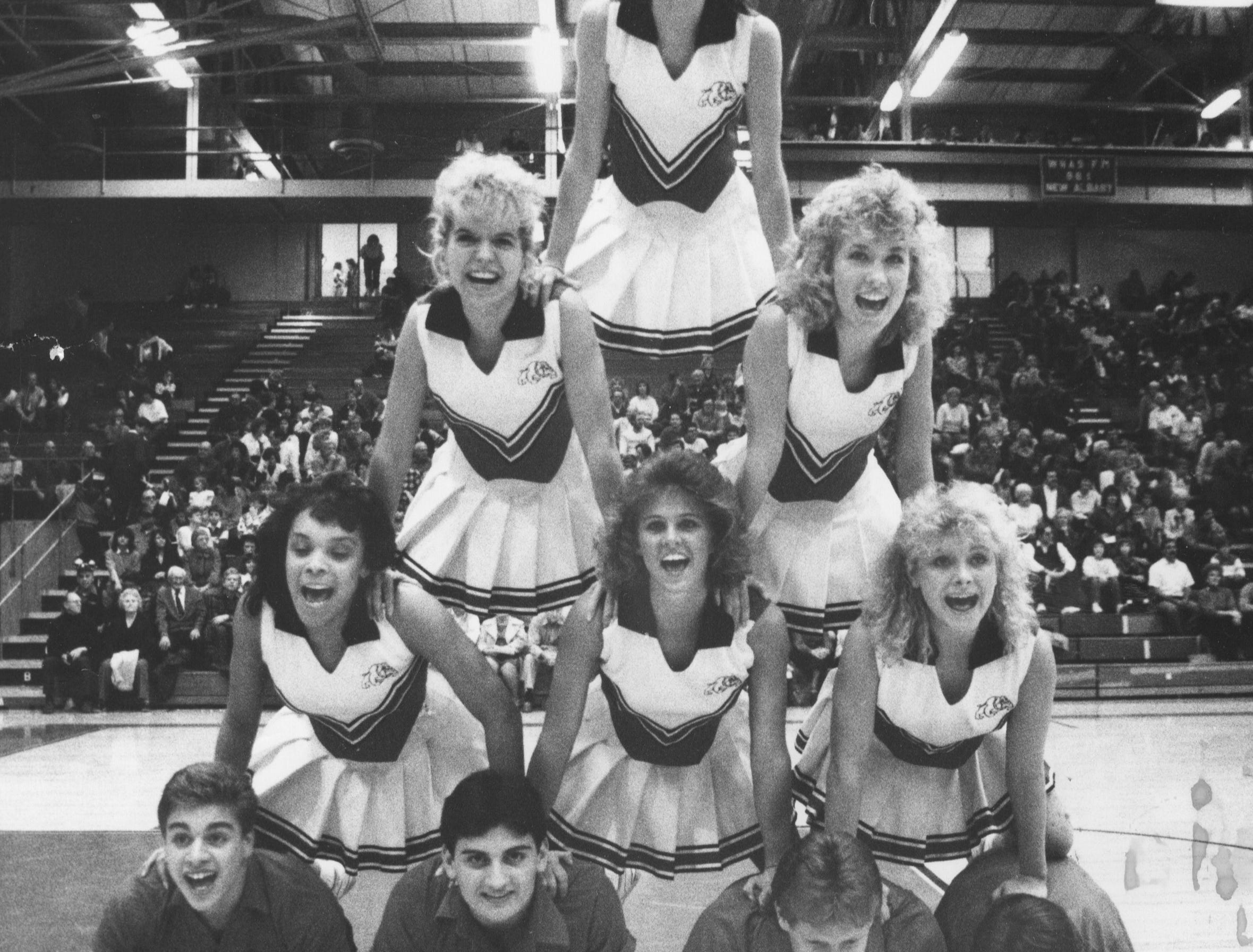 The New Albany High cheerleaders have fun at a basketball game. Jan. 14, 1987