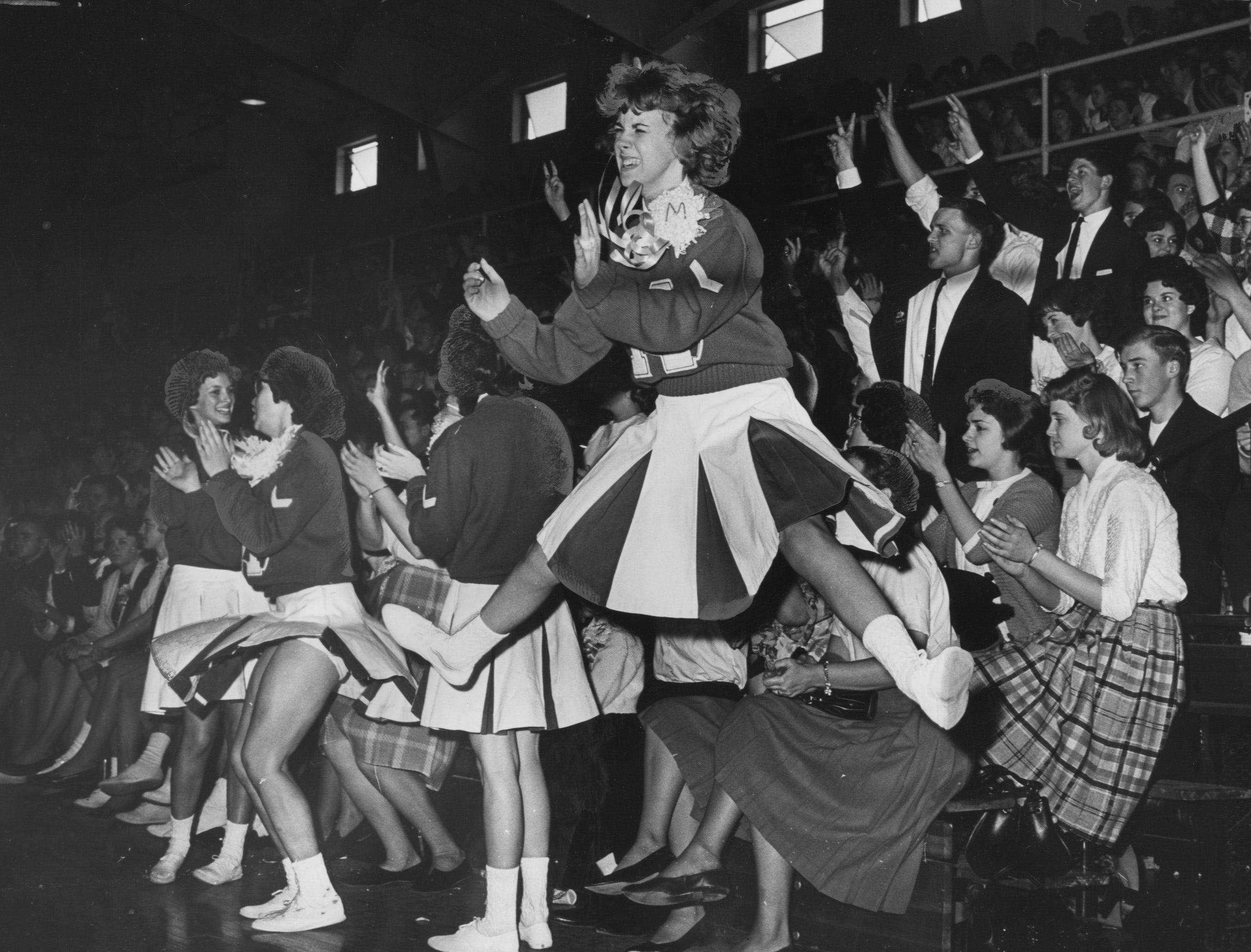 The Morgan  Township cheering section comes alive late i a semi-fins game with Corydon at Salem. Mar. 4, 1963