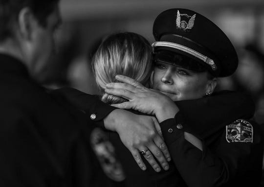 """LMPD officer Justine Bates is hugged as she cries after the funeral for fellow officer LMPD Detective Deidre Mengedoht Monday afternoon at Southeast Christian Church. The two worked out of the Second Division. """"She was such a great person,"""" Bates said."""