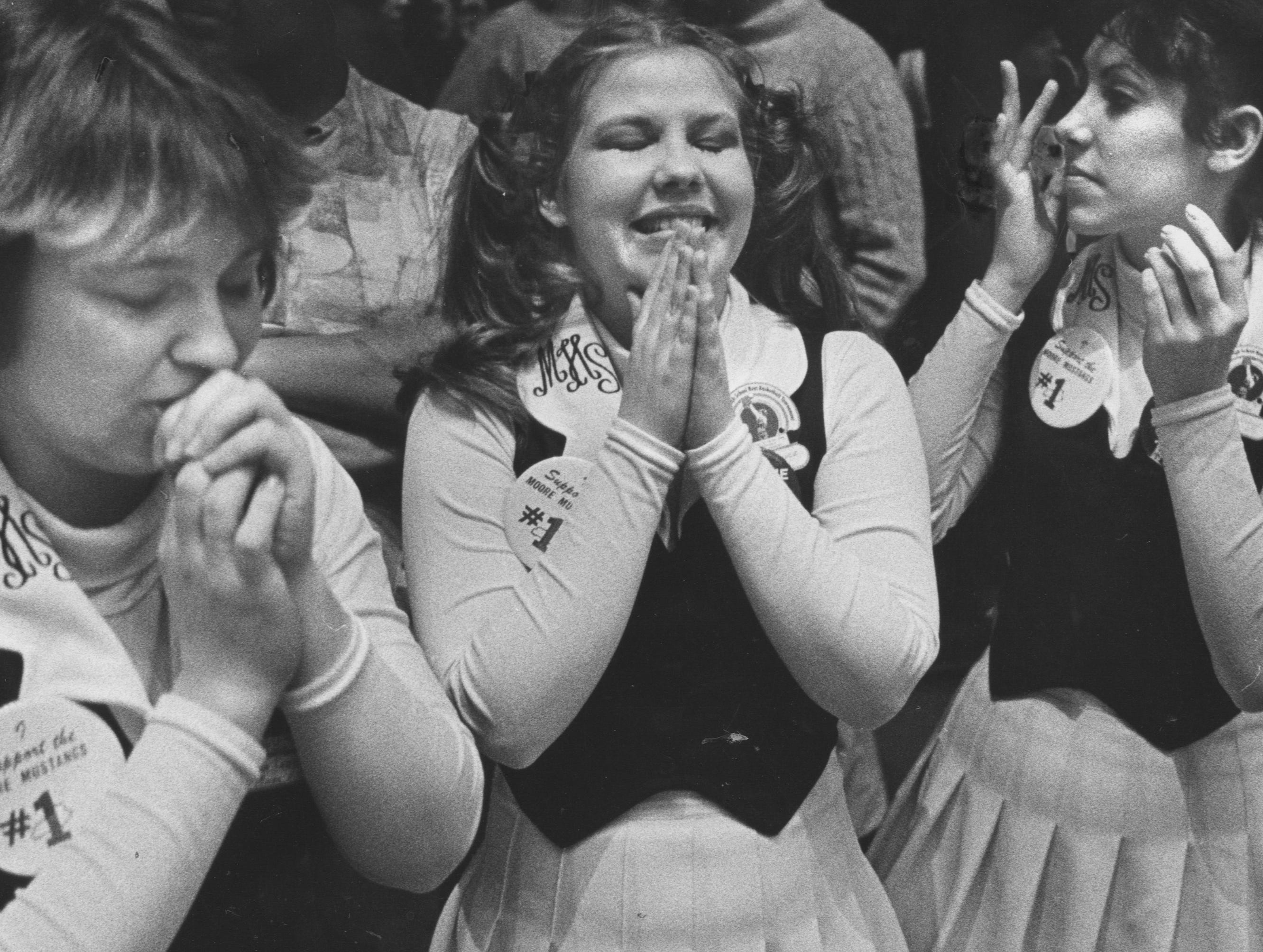 From left, Jeanna Sattich, Donna Groce and Judy Strong tensely awaited the outcome of Moore High School's first game against Oldham County in the Sweet Sixteen of the boys' State High School Basketball Tournament. Mar. 28, 1980