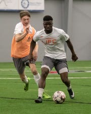John Waller moves the ball up the field during the Lansing Ignite open tryouts Sunday, Jan. 27, 2019 in Brighton.