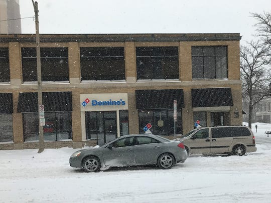 A Domino's Pizza delivery car fills an order during a blizzard on Monday, January 28, 2019.