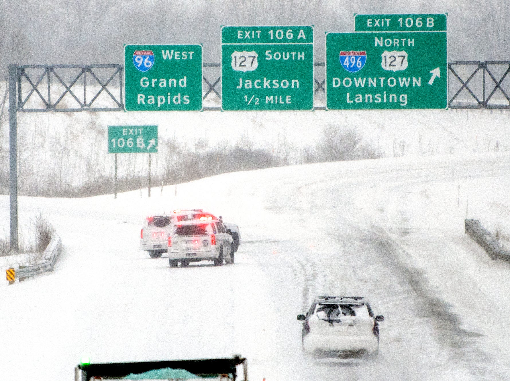 Ingham County Sheriff's Office deputies block the Interstate 96 exit on northbound U.S. 127 due to a crash on Monday, Jan. 28, 2019, in Lansing.