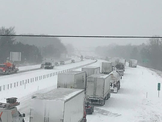 Traffic in both directions of Interstate 96 in Delta Township is slowed for crashes involving semis that jack knifed in the median on Jan. 28, 2019.
