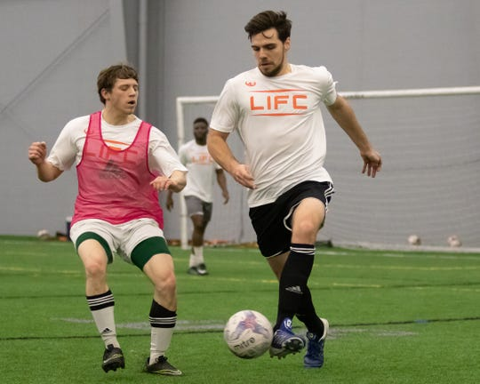 Alec Gnass deftly maneuvers the ball during the Lansing Ignite open tryouts Sunday, Jan. 27, 2019 in Brighton.