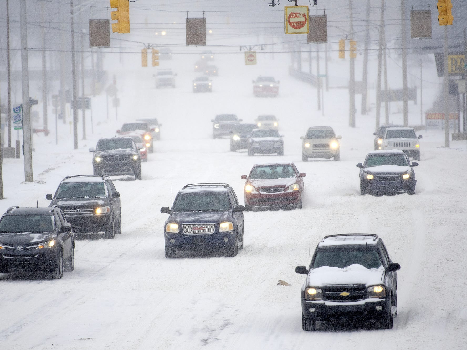 Traffic flows eastbound along Saginaw Street at the Larch Street intersection on Monday, Jan. 28, 2019, in Lansing. A major snow storm hit the region Monday and will be followed by days of bitter, life-threatening cold.