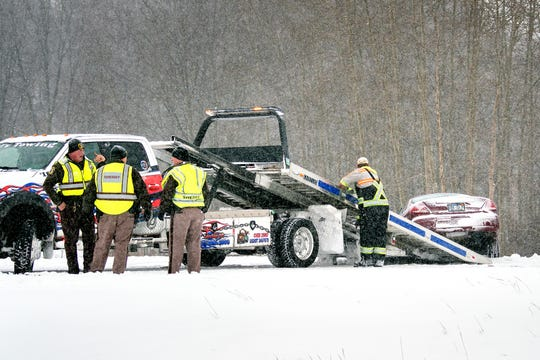 Ingham County Sheriff's Office deputies work the scene of a multi-vehicle crash at the Interstate 96 exit on northbound U.S. 127 on Monday, Jan. 28, 2019, in Lansing.
