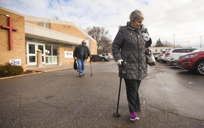 """It's about the fellowship,"" Joseph and Patricia Weems of Lansing said as they leave St. Casimir Church Wednesday afternoon, Jan. 16, 2019, after having lunch served by the Southside Community Kitchen.  ""We love chatting and catching up with people, we've all become friends, we get to get to know eachother really well,"" Patricia said."