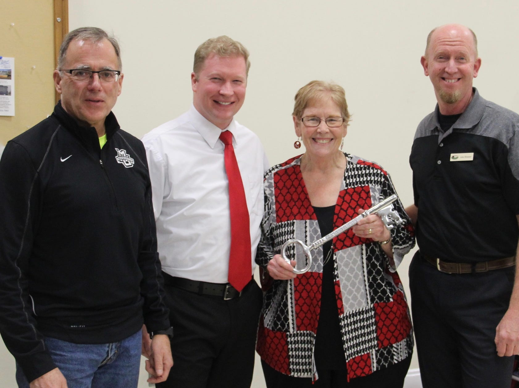 Friends of Mariners Trail past president and board member Judy Corrado was presented a key to the cityby Manitowoc MayorJustin Nickels Jan. 23. Pictured from left:FOMT treasurer and Manitowoc District 5 Ald. Lee Kummer, Nickels, Corrado and FOMT PresidentJohn Brunner.