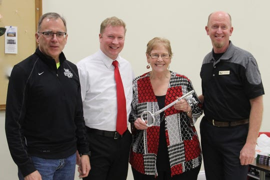 Friends of Mariners Trail past president and board member Judy Corrado was presented a key to the city by Manitowoc Mayor Justin Nickels Jan. 23. Pictured from left: FOMT treasurer and Manitowoc District 5 Ald. Lee Kummer, Nickels, Corrado and FOMT President John Brunner.