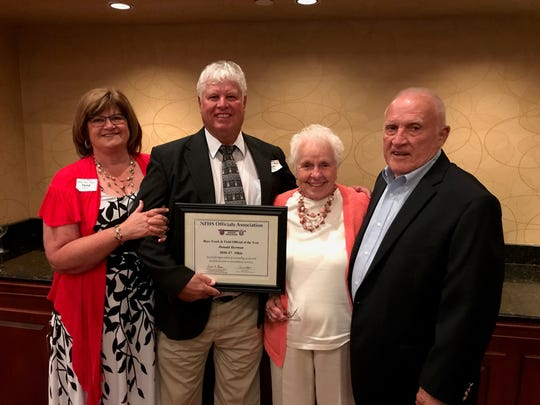 Don Herman with his wife, Tena, and the Wards, Shirley and Al, after Herman was named the Track and Field Official of the Year in Ohio for the 2016-17 season.