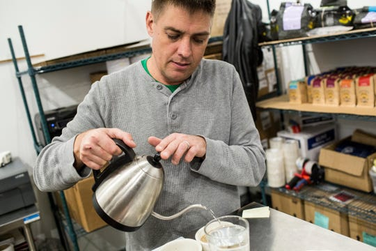 January 27 2019 - Geoffrey Meeker, owner of French Truck Coffee, pours water over freshly ground coffee beans while showing a coffee Cupping at French Truck Coffee in Crosstown Concourse.