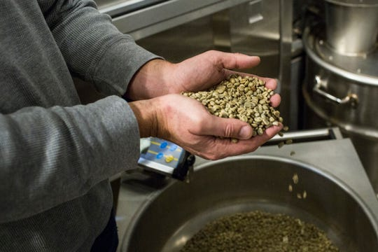January 27 2019 - Geoffrey Meeker, owner of French Truck Coffee, shows off coffee beans before they are roasted at French Truck Coffee in Crosstown Concourse.