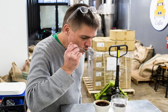 January 27 2019 - Geoffrey Meeker, owner of French Truck Coffee, tastes coffee while showing a coffee cupping at French Truck Coffee in Crosstown Concourse.
