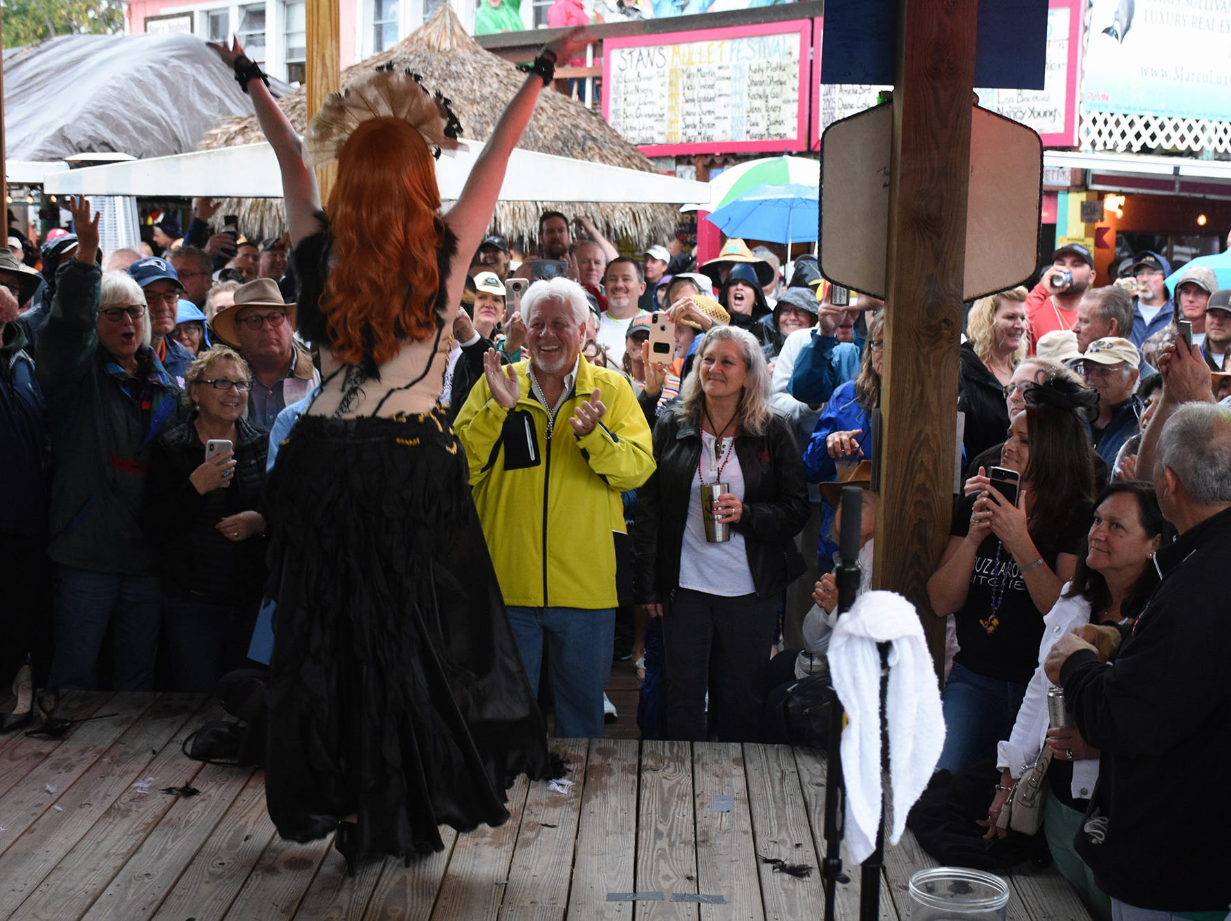 Kat Ebaugh of Marco Island was named first runner-up. in a photo finish. Stan's Idle Hour restaurant held The 35th annual Mullet Festival over the weekend, a rain and beer-soaked celebration.