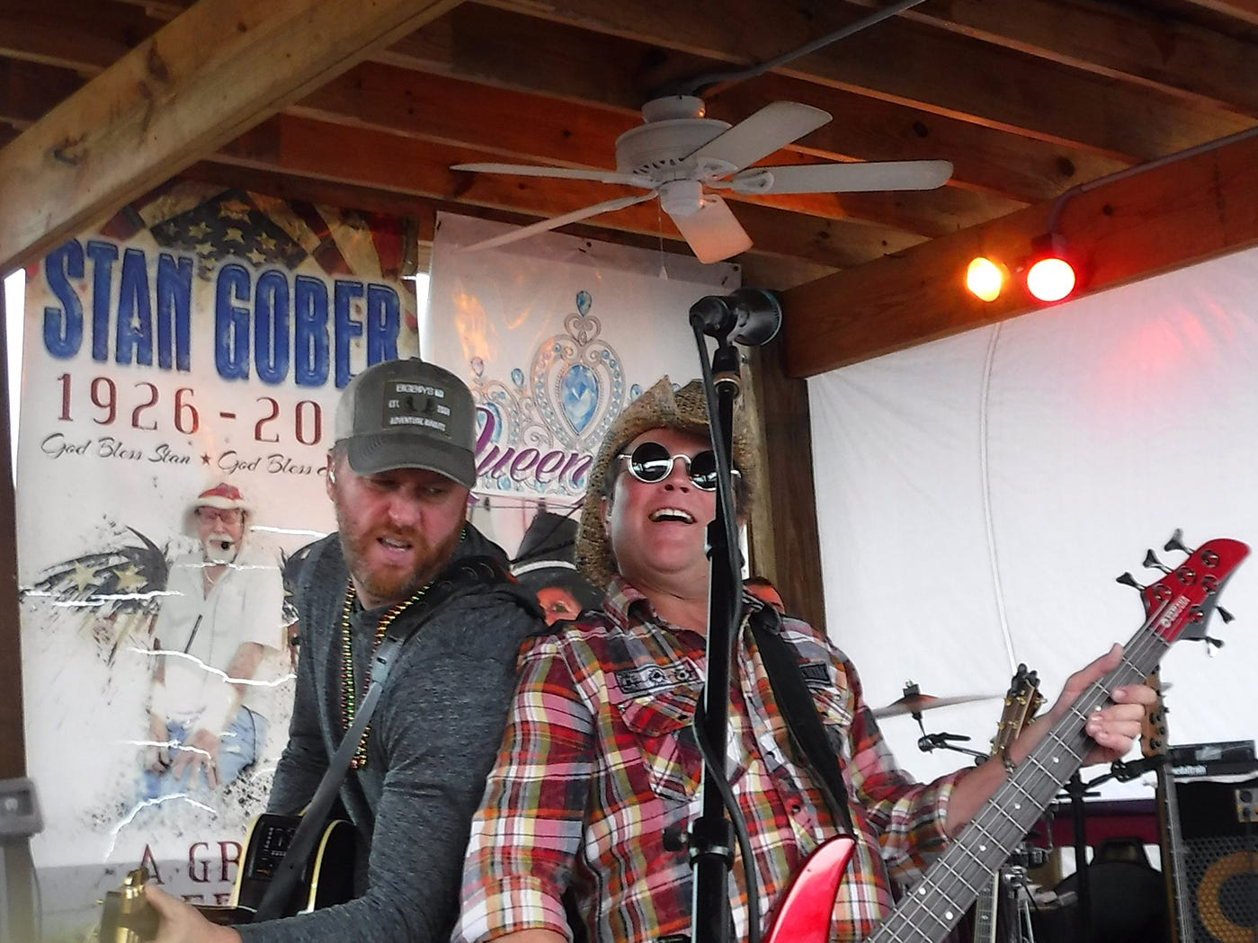 The Ben Allen Band, with Ben at left, pumps out the tunes. Stan's Idle Hour restaurant held The 35th annual Mullet Festival over the weekend, a rain and beer-soaked celebration.