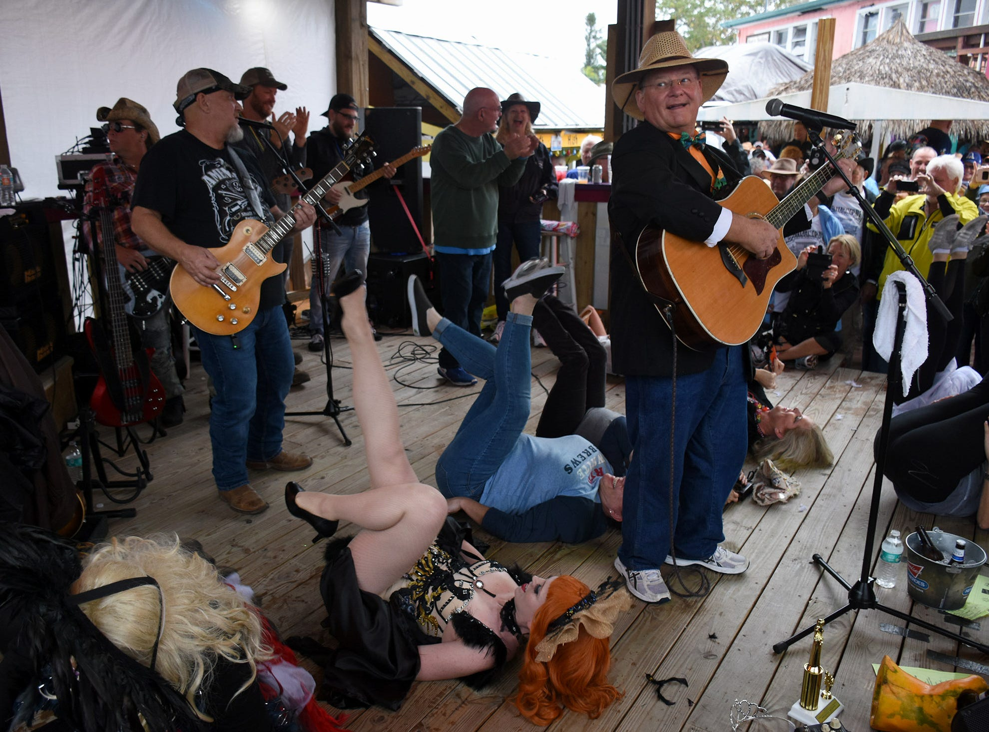 Emcee Jeff Hilt calls the Buzzard Lope tune. Stan's Idle Hour restaurant held The 35th annual Mullet Festival over the weekend, a rain and beer-soaked celebration.