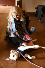 MIHS board member Tish Champagne pets a dog from Domestic Animal Services up for adoption. The return of the Key Marco Cat and associated artifacts became offical Saturday, with a celebration and ribbon cutting held at the Marco Island Historical Museum.