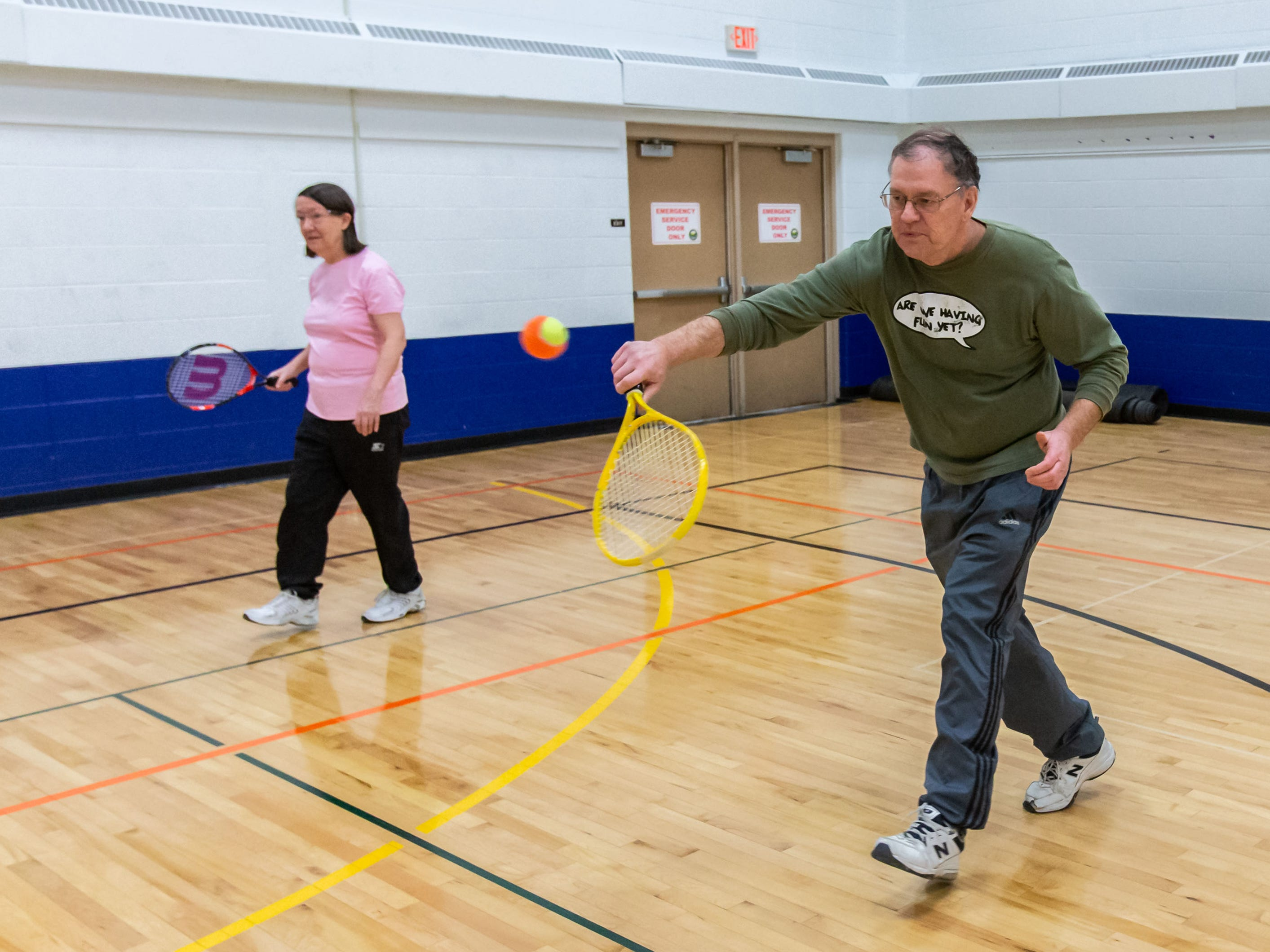 Russ and Jill Hager of Muskego play a game of progressive tennis during the JanBoree family carnival at the Schuetze Recreation Center in Waukesha on Sunday, Jan. 27, 2019. The carnival featured arts and crafts, games, theatrical performances and more.