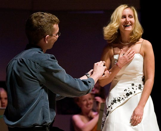 "Nick Beaudin proposes to Carlie following the song ""Come What May"" that they sang together during the South Shore Youth Opera Ensemble's La Musica Bella on Aug. 15, 2007, at the South Milwaukee Performing Arts Center."