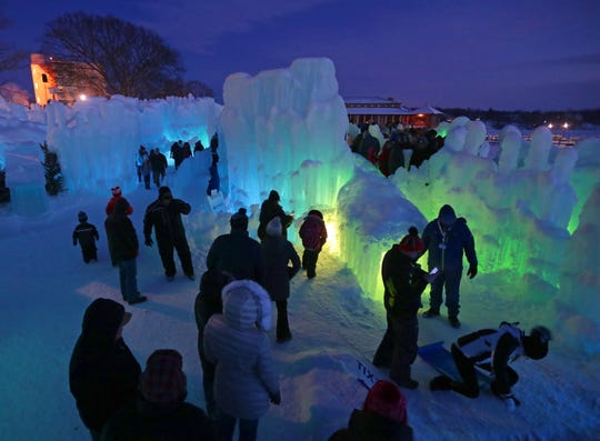 LED lights illuminate the ice formations at the Ice Castles display in Lake Geneva in January 2019.