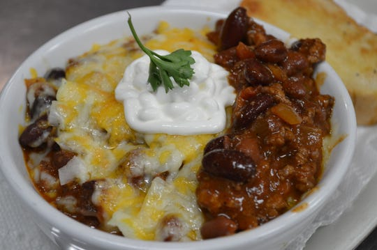 The chili at Romey's Place Bar and Grill has ground beef, bacon, onion, celery, beans and special seasonings, and is topped with fixings like cheese, onions and sour cream. A bowl is served with bread and/or crackers for $6.