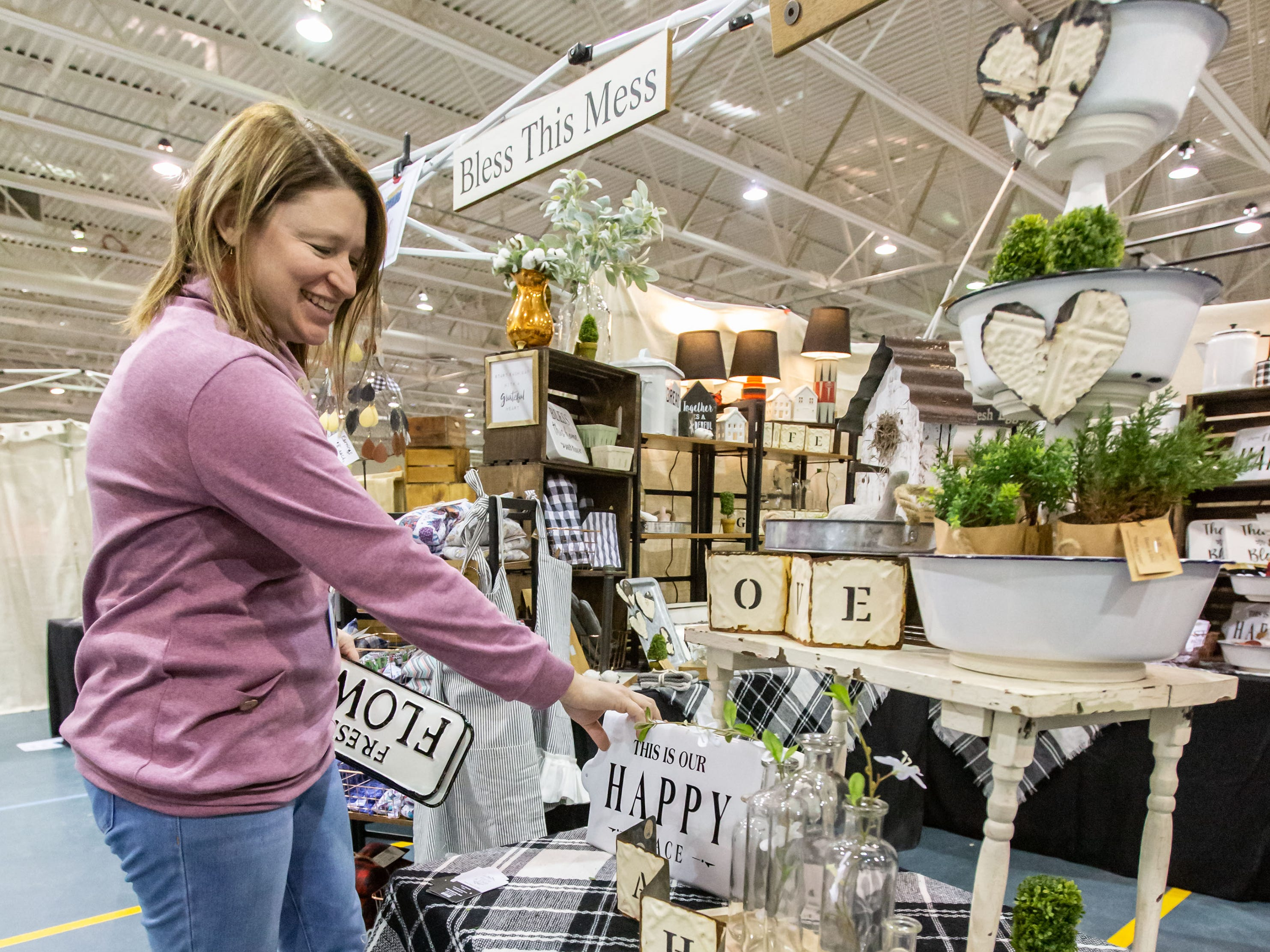 Kate Petersen of Hattie and Elsie in Janesville organizes her booth during the re:Craft and Relic show at the Milwaukee County Sports Complex in Franklin on Sunday, Jan. 27, 2019. The show offers vintage, upcycled, antique, handcrafted, reclaimed, and locally-sourced goods.