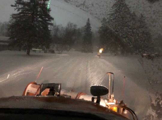 It was barely sunrise as a Hales Corners plow cleared a road as snow still fell relentlessly in the early hours of Monday, Jan. 28. The plow had already been on the streets for hours, starting at 3 a.m.