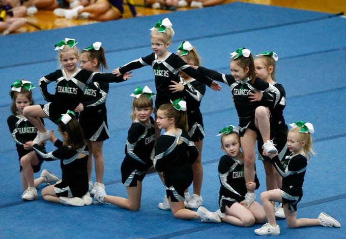 The Kettle Moraine Junior Charger - Twinkles compete in the Elementary Mini division during the iCheer Competition at Greendale High School on Jan. 26.