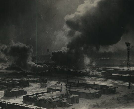 Clouds of steam and smoke swirl up from the Milwaukee Road rail yards, seen from the 27th Street viaduct on Jan. 30, 1951. The temperature that day fell to 24 below zero. This photo was published in the Jan. 30, 1951, Milwaukee Journal.