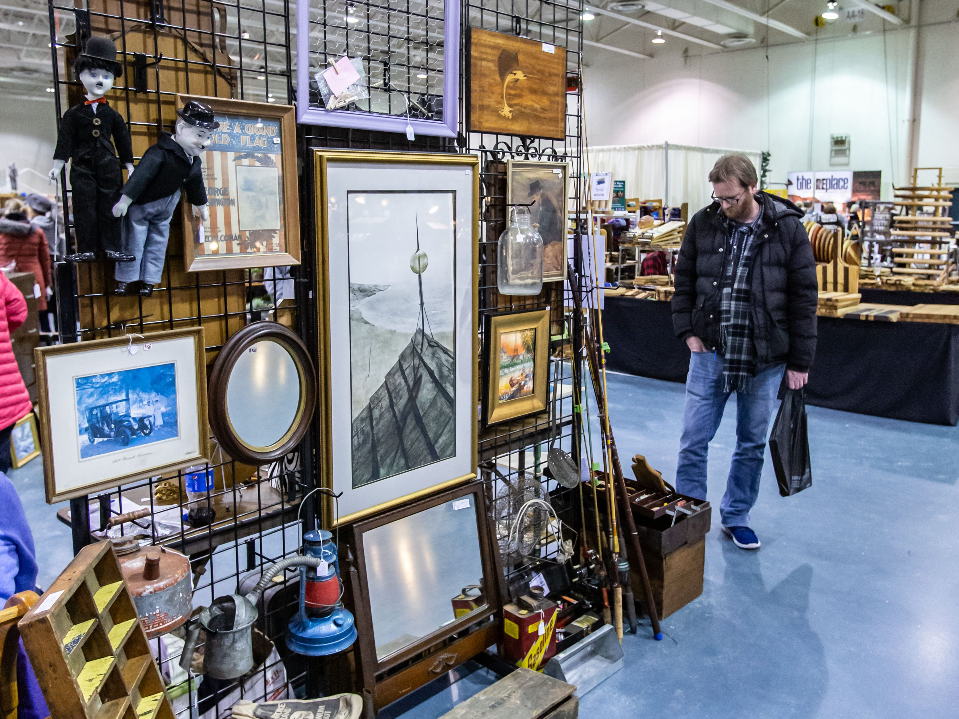 Customers browse a huge selection of vintage, upcycled, antique, handcrafted, reclaimed, and locally-sourced goods during the re:Craft and Relic show at the Milwaukee County Sports Complex in Franklin on Sunday, Jan. 27, 2019.