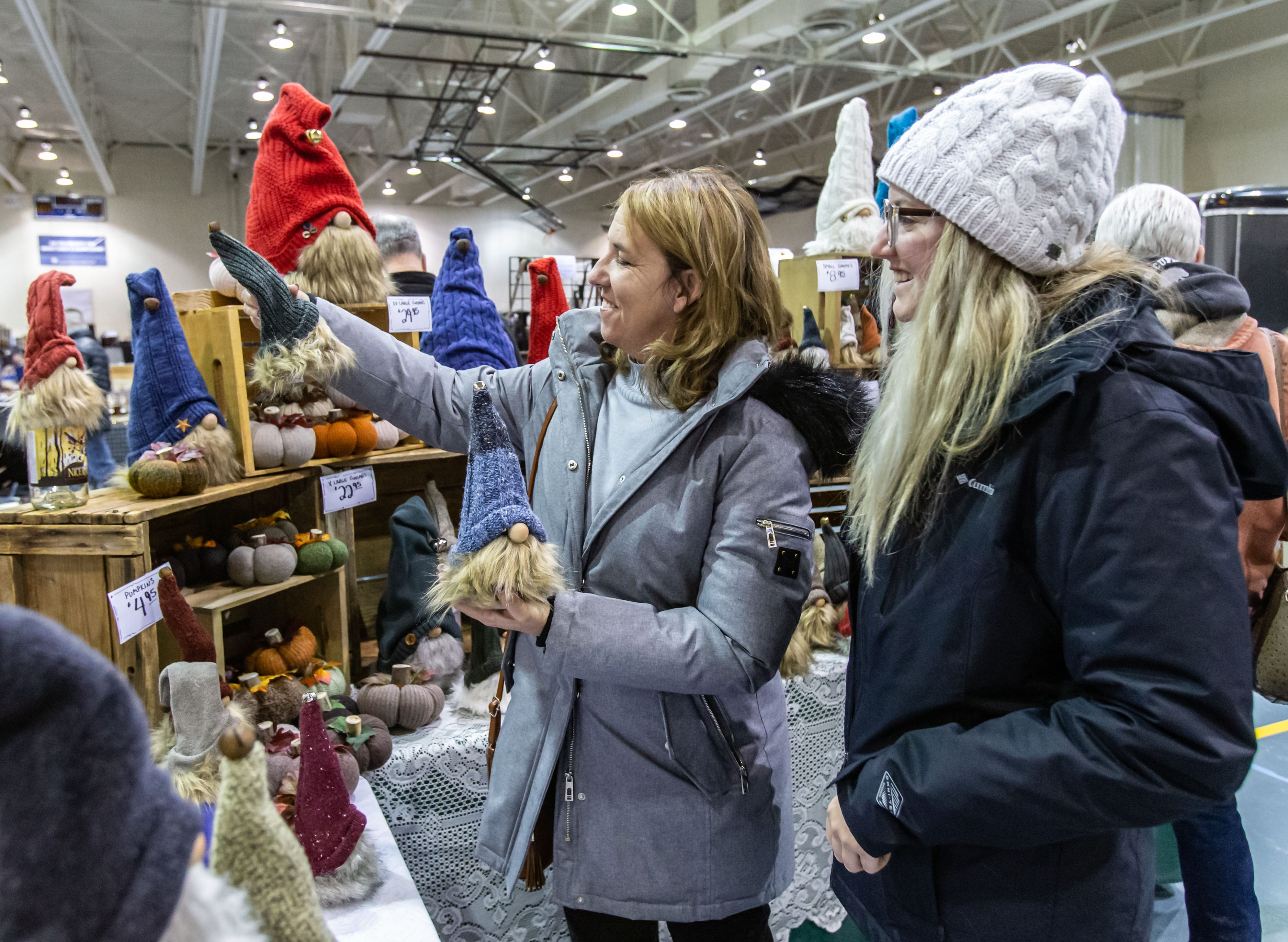 Julie March (left) of Waukesha and her daughter Katelyn shop for handmade gnomes during the re:Craft and Relic show at the Milwaukee County Sports Complex in Franklin on Sunday, Jan. 27, 2019. The show offers vintage, upcycled, antique, handcrafted, reclaimed, and locally-sourced goods.
