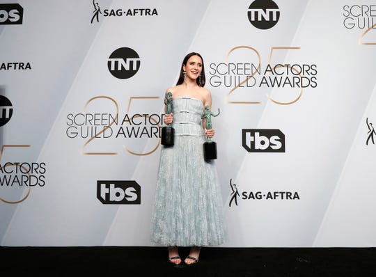 "Rachel Brosnahan poses with the SAG Award for best performance by a female actor in a comedy series and best ensemble for a comedy series for ""The Marvelous Mrs. Maisel"" Sunday night in Los Angeles."