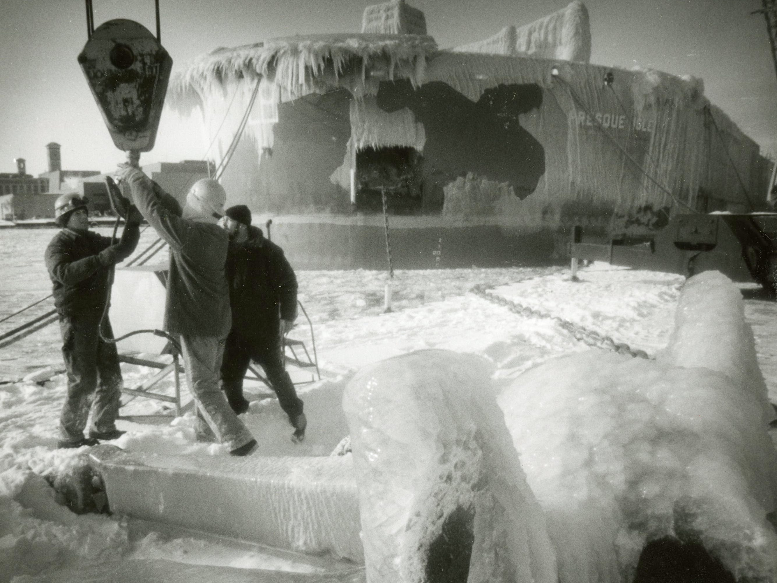 Dock workers set the anchor and lines for the freighter Presque Isle at a dock on Jones Island in Milwaukee in January 1994. Milwaukee area temperatures reached 21 below zero that month. This photo was published in the Jan. 30, 1994, Milwaukee Journal.