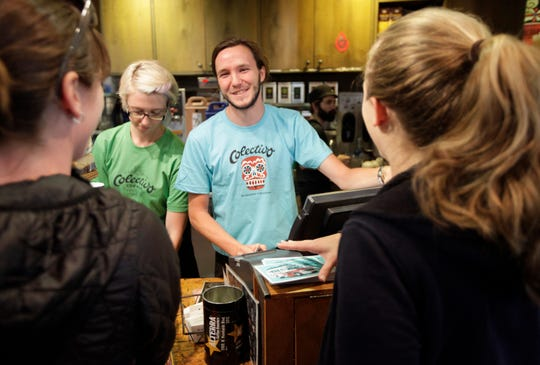 Francis Sullivan helps customers at the Colectivo cafe at 2999 N Humboldt Blvd.
