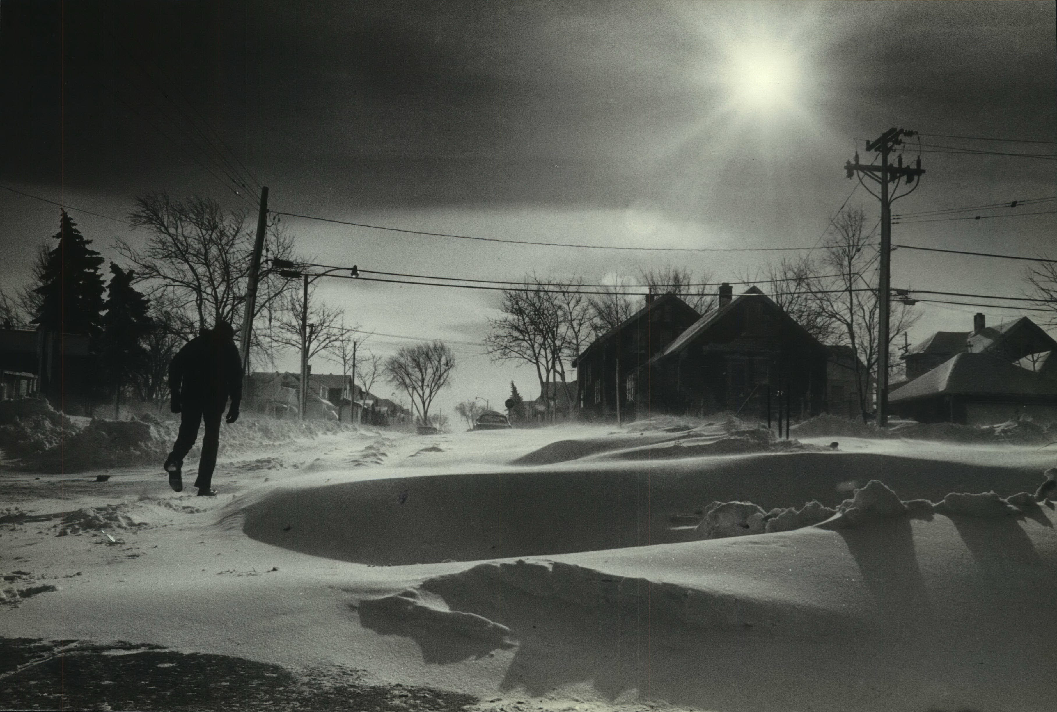 A lone walker huddles against the cold as he made his way up the 4300 block of North 14th Street on Jan. 10, 1982. The temperature that day dropped to 25 below zero, tying Milwaukee's all-time record low at the time. (It was broken a week later, when temperatures hit 26 below.) This photo was published in the Jan. 11, 1982, Milwaukee Journal.